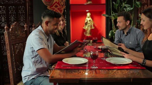 Thumbnail for Young People Chooses Meal In The Indian Restaurant