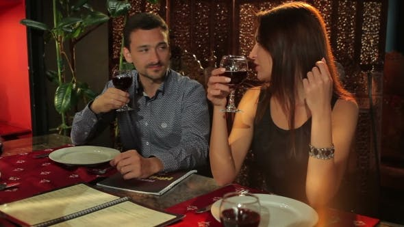 Thumbnail for Man And Woman Talking With Friends In Restaurant