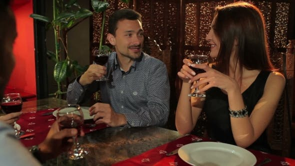 Thumbnail for The Couple Are Talking With Friends In Restaurant