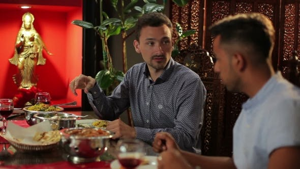 Thumbnail for Two Men Dining At The Restaurant