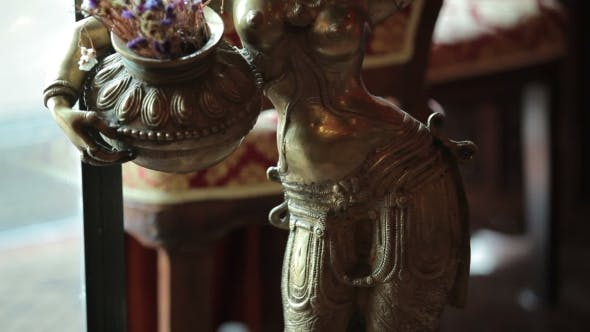 Thumbnail for Beautiful Indian Statuette With Girl In Restaurant