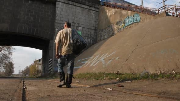 Homeless Man Walking in City