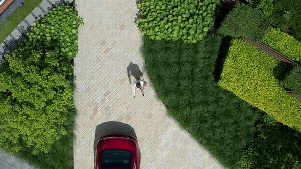 Thumbnail for Drone Shot of Female Walking To Car and Getting in