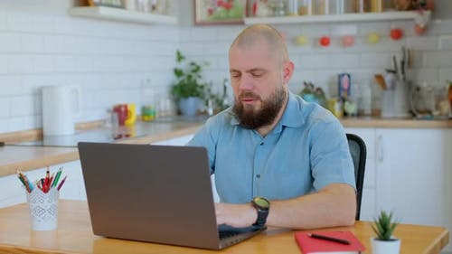 Beared Aged Man Learning Online