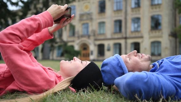 Cover Image for Happy College Students Relaxing After Studying