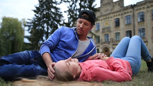 Thumbnail for Attractive Student Couple Resting At Campus