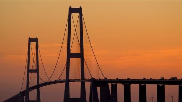 Thumbnail for Great Belt Bridge View Against Orange Sky at Dawn