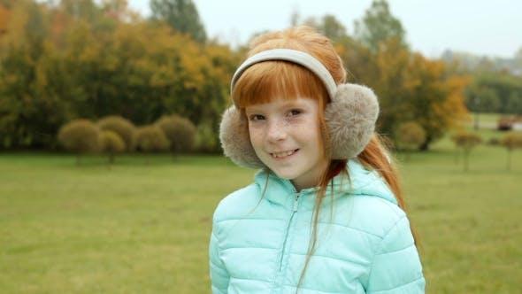 Thumbnail for Ginger Girl In The Earmuffs Smiling