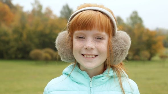 Cover Image for Ginger Girl In The Earmuffs Winking