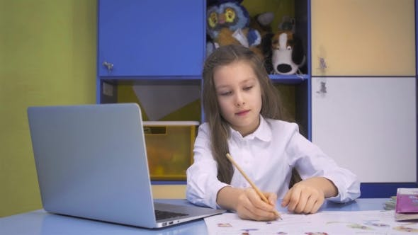 Thumbnail for Girl Using a Laptop Computer At School