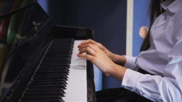 Thumbnail for Young Girl Playing Piano In School Class