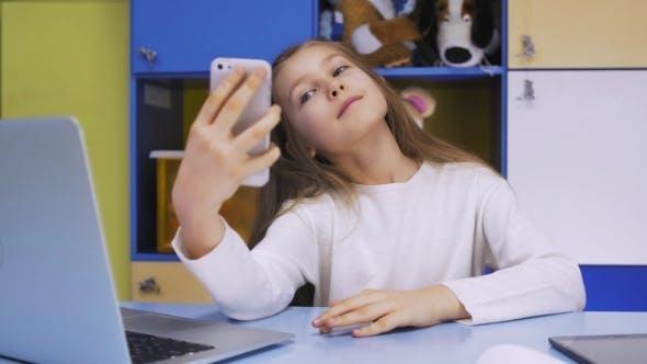 Thumbnail for Girl Taking Selfie On Phone At School
