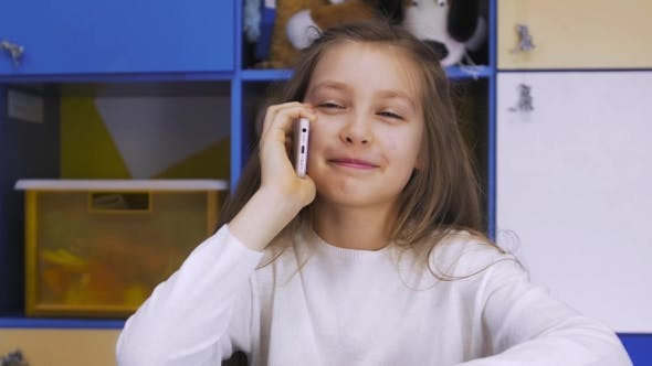 Thumbnail for Cute Little Girl Using Modern Smartphone
