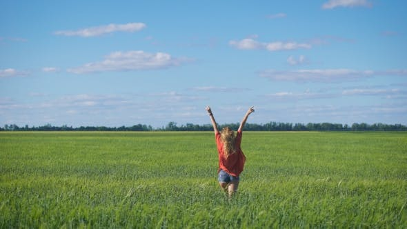 Thumbnail for Charming Blonde Woman At a Green Field