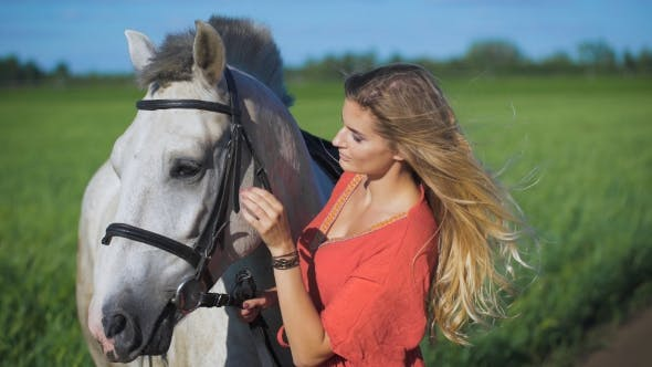 Thumbnail for Beautiful Blonde Girl Standing With a Horse At a Countryside