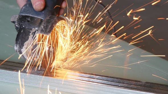 Thumbnail for Man Sawing Metal By Grinder