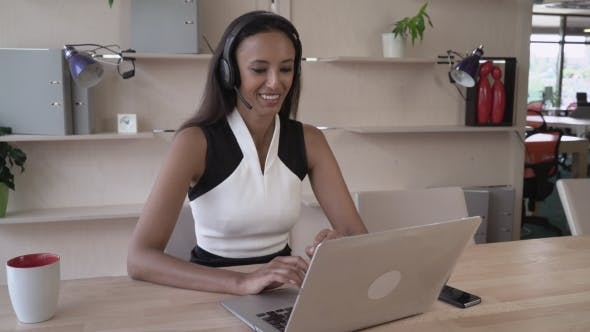 Happy Mixed Race Businesswoman Talking On The Phone Using
