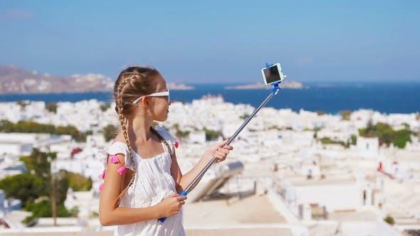 Adorable Little Girl Taking Selfie Photo Background Mykonos Town In Greece