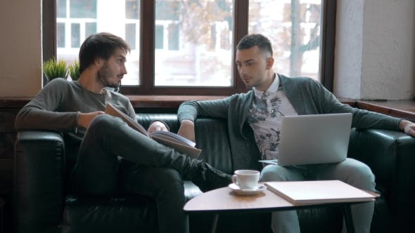 Thumbnail for Two Entrepreneurs Working And Taking Notes Together In Table Of a Little Office