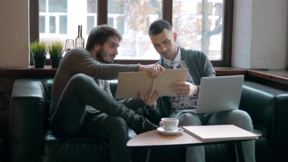 Thumbnail for Two Entrepreneurs Working And Taking Notes