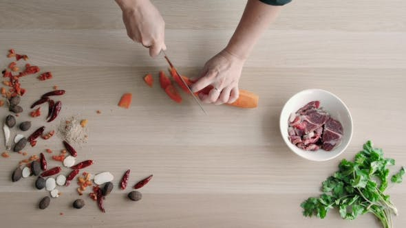 Thumbnail for Top View Of Chefs Hands Chopping Carrot On Wooden Board, Healthy Food Concept