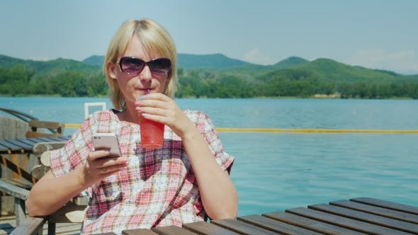 Cover Image for Woman Resting On a Summer Area In The Cafe