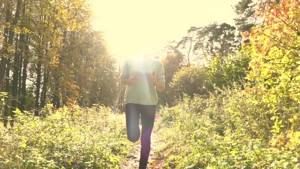 Thumbnail for Pretty Brunette Girl With Ponytail Running In Autumn Forest. Sunny Day, Blazing Sun. Super