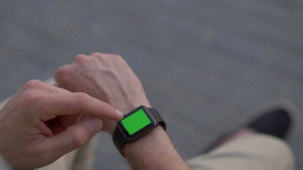 Thumbnail for Man Hands Gestures a Modern Smart Watch With a Green Screen Chroma Key Content