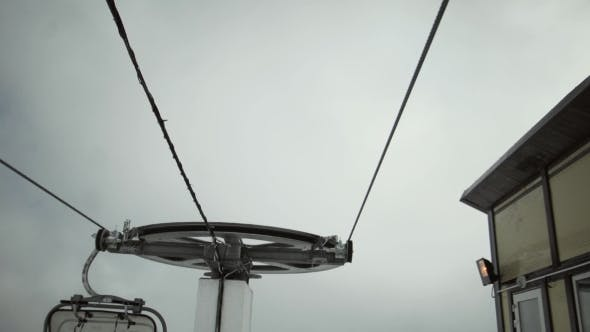 Thumbnail for View Of Ski Lifts Construction At Mountains. Ski Resort. Snowboarding. Open Cabin. Clouds. Height
