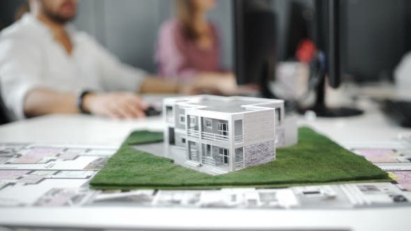 Thumbnail for Businessman Signs Contract Behind Home Architectural Model. .