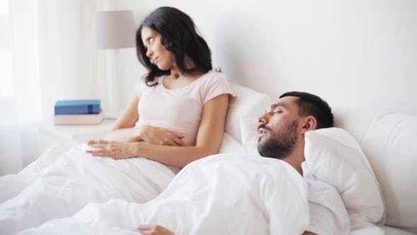 Thumbnail for Angry Woman Waking Man Sleeping In Bed