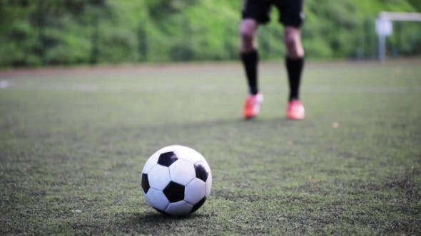 Thumbnail for Football Player Playing With Ball On Field