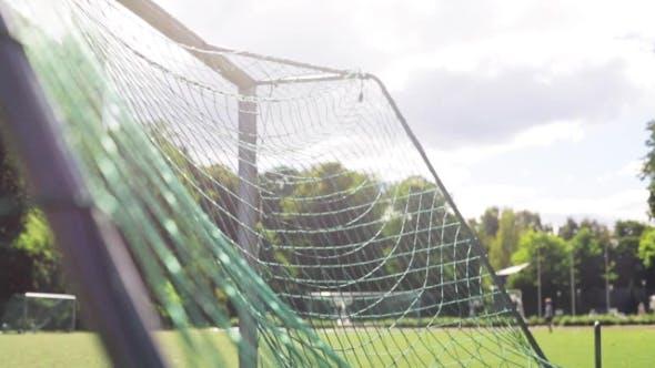 Thumbnail for Ball Flying Into Football Goal Net On Field
