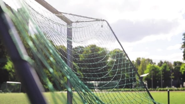 Thumbnail for Ball Flying Into Football Goal Net On Field