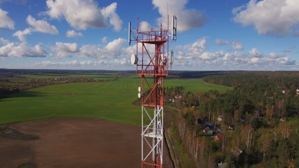 Thumbnail for Aerial view of a telecommunication cell phone tower standing in the field