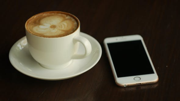 Thumbnail for Using Smartphone With Coffee