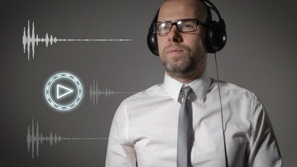 Thumbnail for Businessman In a Shirt And Big Headphones, Click On The Play Button And Start Listening To Music.