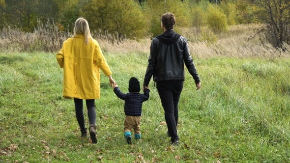 Thumbnail for Young Family On a Walk In The Park