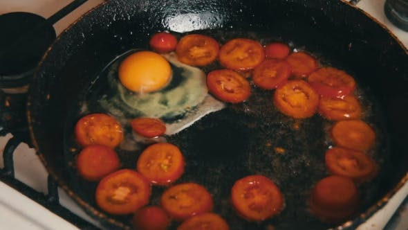 Thumbnail for Fried Eggs With Tomatoes Prepared On a Frying Pan