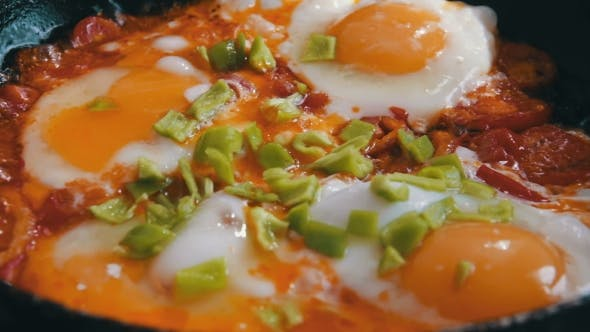 Thumbnail for Fried Eggs With Vegetables Prepared On a Frying Pan