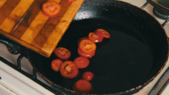 Thumbnail for The Cut Tomatoes Are Fried In Olive Oil