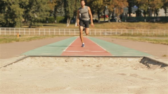 Thumbnail for Male Athlet Has a Bad Landing After Long Jump