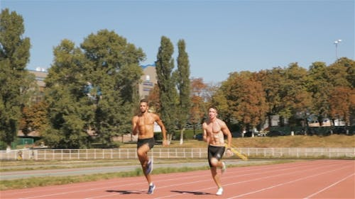 Two Athlets Sprinting At The Stadium