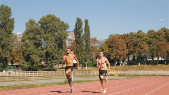 Thumbnail for Two Athlets Sprinting At The Stadium