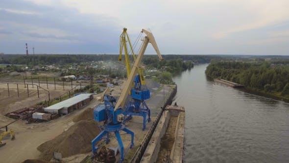 Thumbnail for Aerial view:River Port With Cranes And Ships.