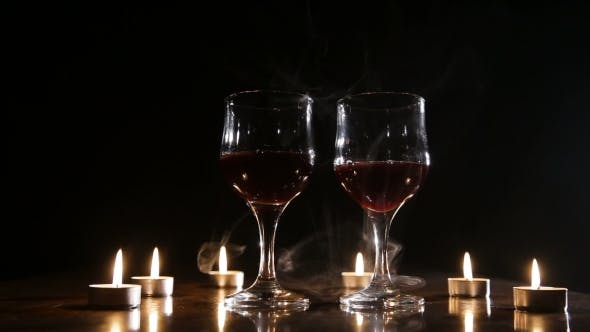 Thumbnail for Wine Glasses and Burning Candles in the Smoke.
