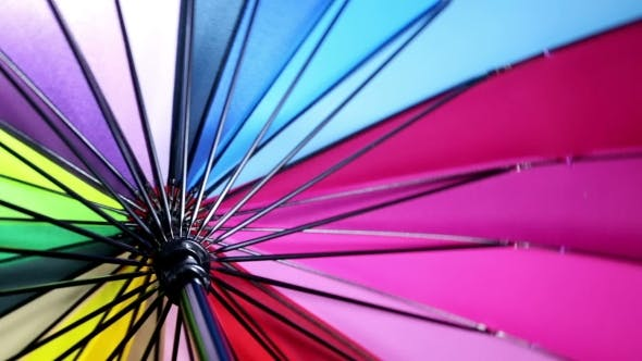 Thumbnail for Multicolored Umbrella Rotates Background