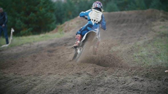 Thumbnail for Motocross Racer Jumping. Rear View of Biker on Track in Rapid Shoot