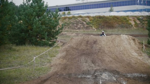 Thumbnail for Motocross Racer Mxgirl On Dirt Bike Jumping On Track