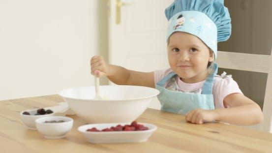 Thumbnail for Adorable Toddler At Mixing Bowl